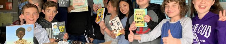 Students unpack new books.